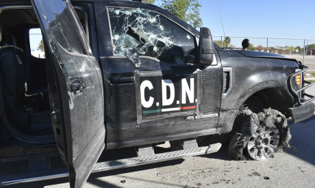 A damaged pick up truck marked with the initials C.D.N