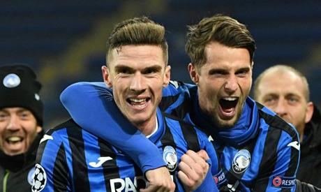 Atalanta defender Robin Gosens (L) celebrates with Hans Hateboer (R) as debutants Atalanta reached t