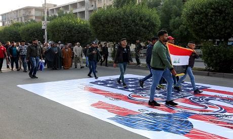 Supporters of Asaib Ahl al-Haq