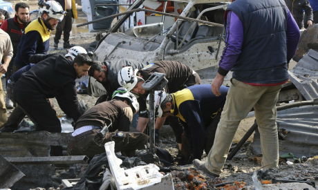 Members of the Syrian Civil Defense transporting an injured person
