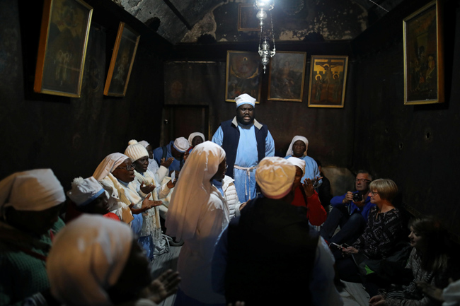 Worshippers pray inside the Church of the Nativity on Christmas eve in Bethlehem, in the Israeli-occ