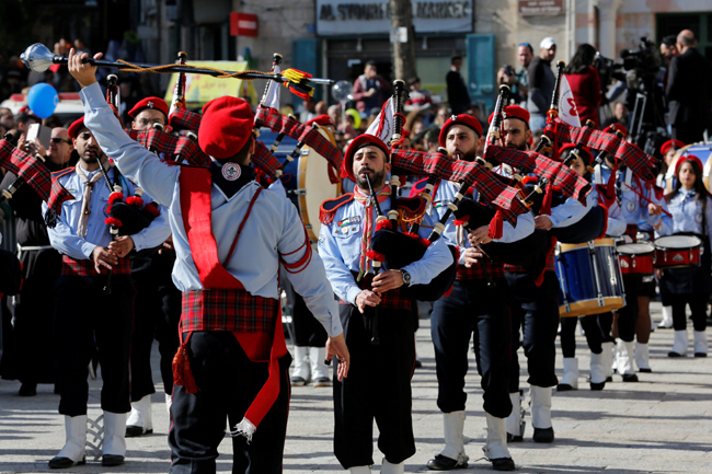 Members of a Palestinian scout band perform during Christmas celebrations at Manger Square in Bethle