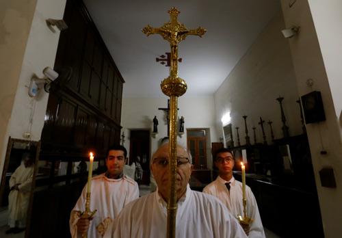 A priest leads the Christmas eve mass at Saint Joseph