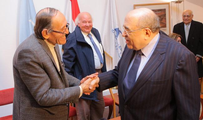 Director of Bibliotheca Alexandrina Mustafa El-Feki congratulates visual artist Ezz El-Din Naguib