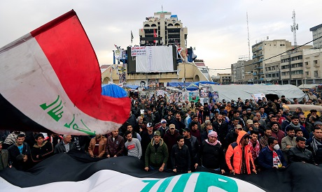 Iraqi demonstrators carry Iraqi flags