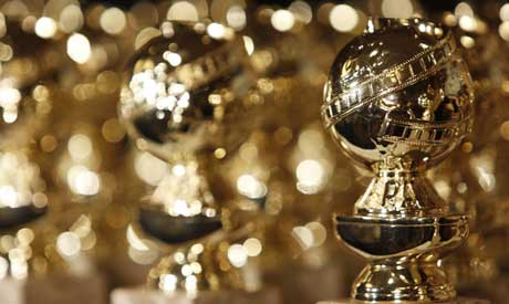 Golden Globe statuettes are displayed (AP)