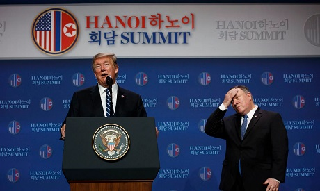 President Donald Trump speaks as Sec of State Mike Pompeo looks on during a news conference after a