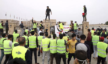 Protesters in Iraq have been wearing yellow vests since December (Photo: AP)