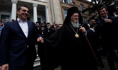 Ecumenical Patriarch Bartholomew I and Greek Prime Minister Alexis Tsipras walk together at Halki Gr