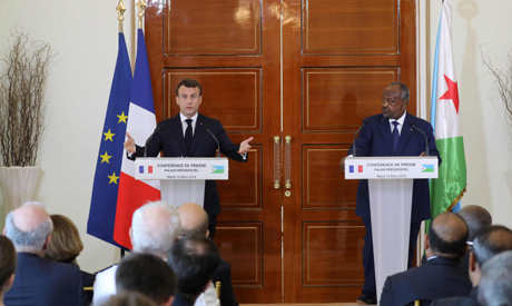 French president Emmanuel Macron (L) holds a press conference with Djibouti president Ismael Omar Gu