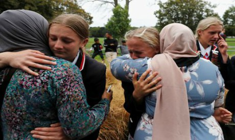 Christian students give hugs to Muslims at a community centre, following shooting in Christchurch