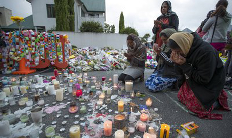 People mourn at a makeshift memorial site near the Al Noor mosque in Christchurch, New Zealand
