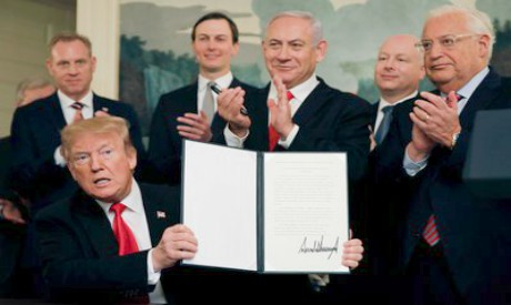 US President Donald Trump holds a proclamation