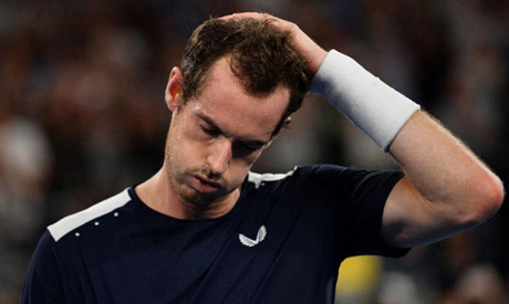 Andy Murray reacts after defeat against Roberto Bautista Agut at the 2019 Australian Open (AFP)
