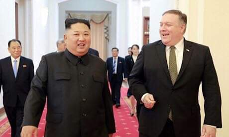 Kim Jung Un and Mike Pompeo
