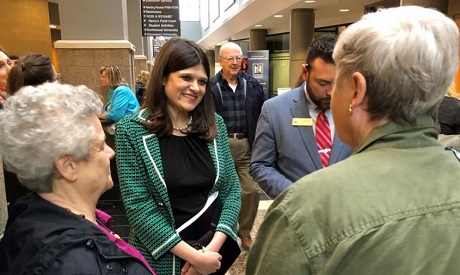 U.S. Representative Haley Stevens speaks with constituents at a town hall meeting in Livonia, Michig