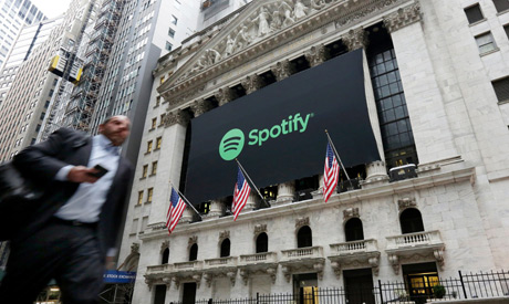 In this April 3, 2018 file photo, a Spotify banner adorns the facade of the New York Stock Exchange.