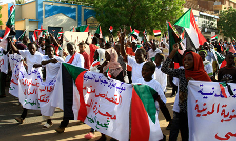 Sudanese demonstrators, from the Nuba mountains, take part in a demonstration in the capital Khartou