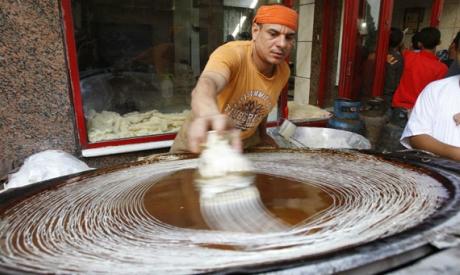 Egyptian man prepares kunafa