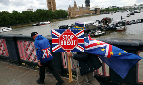 Anti-Brexit protester Steve Bray (R) walks after a Liberal Democrats news conference following the r