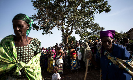(FILES) In this file photo taken on March 02, 2018 Internally Displaced Congolese wait inside a Inte