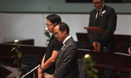 Pro-democracy lawmakers hold five minutes of silence in the Legislative Council on Jun 19. (AFP)