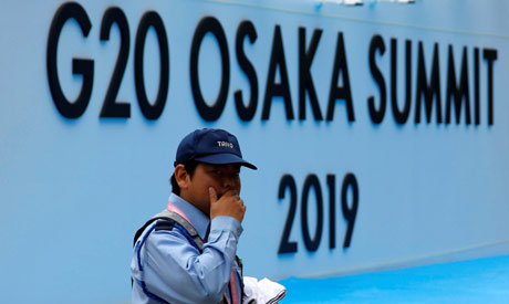 A security officer walks past at the venue of G20 leaders summit in Osaka, western Japan June 26, 20