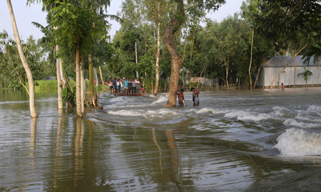 Bangladeshi people look at flood waters in Kurigram district, in the northern part of Bangladesh.(AF