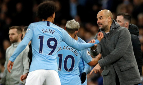 Pep Guardiola and Leroy Sane (Reuters)