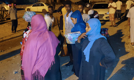 People gather outside Tajoura Detention Center after an airstrike killed nearly 40, east of Tripoli
