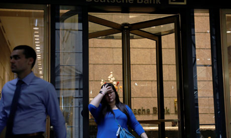 People exit the lobby of the U.S. headquarters of Deutsche Bank in New York City, U.S., July 8, 2019