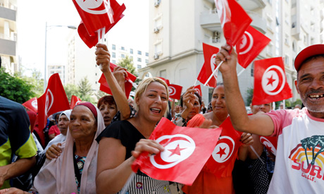 Supporters react after Tunisian Prime Minister Youssef Chahed submitted his candidacy for the presid