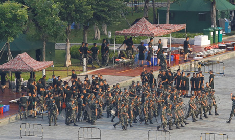 Chinese soldiers walk in formation on the grounds of the Shenzhen Bay Sports Center in Shenzhen acro
