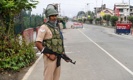 A security personnel keeps guard at a check point during lockdown in Srinagar on August 15, 2019. (A