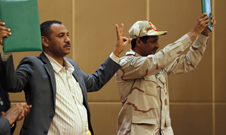 Mohammed Hamdan Dagalo, the deputy head of the  military council, right, and protest leader Ahmad Ra