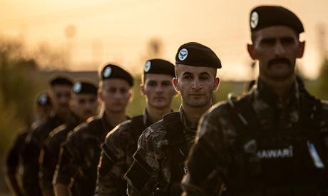 Members of the Kurdish Internal Security Police Force of Asayish (AFP)