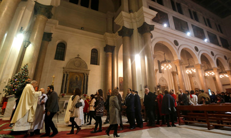 File photo : Egyptian Catholics stand in line to receive Holy Communion during a mass on Christmas e