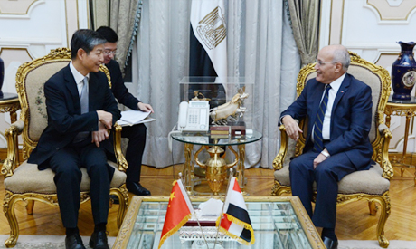 Military Production Minister Mohamed Saeed El Assar (R) with Chinese Ambassador to Egypt Liao Liqian