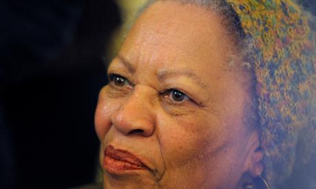FILE PHOTO: U.S. author Toni Morrison poses after being awarded the Officer de la Legion d