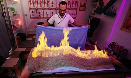 Reuters (Egyptian masseur using fire)