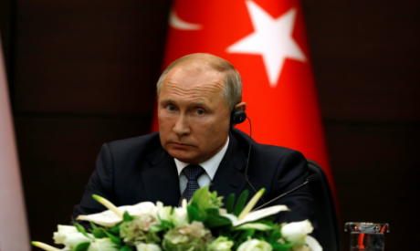 Russian President Putin attends a joint news conference with his counterparts Erdogan of Turkey and
