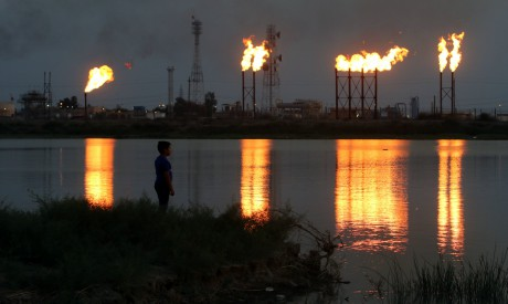 Flames emerge from flare stacks at Nahr Bin Umar oil field, north of Basra