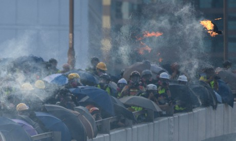 Hong Kong riot police fired tear gas and water cannon at hardcore pro-democracy protesters hurling r