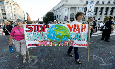 Environmental activists block traffic as part of climate change protest in Washington
