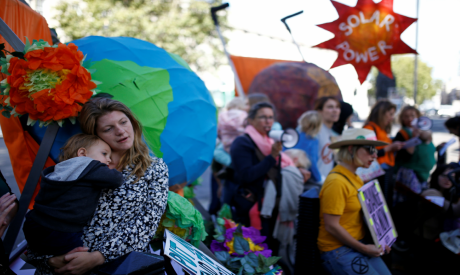 Mothers with prams protest outside Downing Street, ahead of the UN Climate Action Summit, in London
