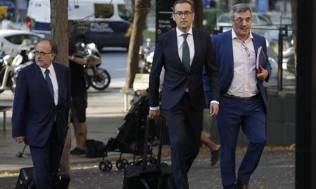 The FC Barcelona legal team arrive at court in Barcelona, Spain, Friday, Sept. 27, 2019. (AP)