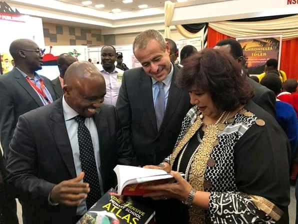 (L-r) Lawrence Njagi and Khaled Al-Abyad with Culture Minister Ines Abdel-Dayem at the NIBF      Pho