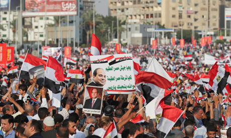 Supporters of President Abdel Fattah Al Sisi supporters chant slogans and raise flags and banners in
