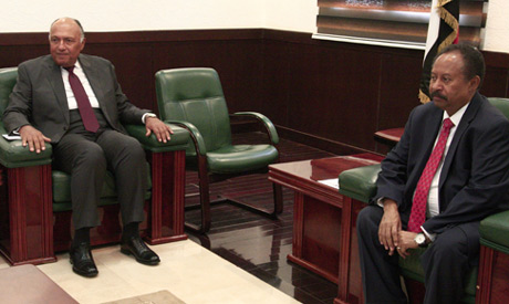 Sudanese Prime Minister Abdalla Hamdok (R) meets with the Egyptian Foreign Minsiter Sameh Shoukry in