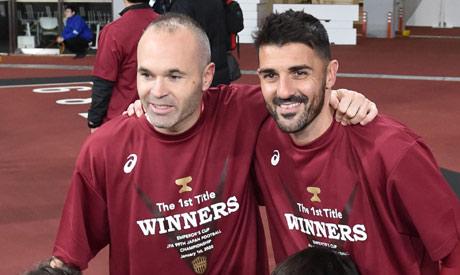 Andres Iniesta (L) and David Villa